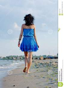 Woman Walking Away On Beach