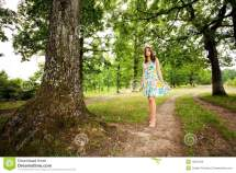 Woman Walking Barefoot in Forest