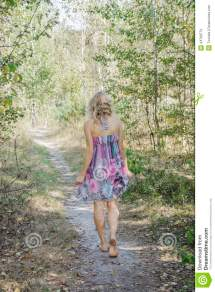 Girl Walking Barefoot in Forest
