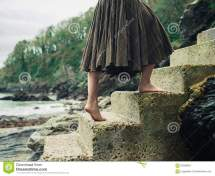 Woman Walking Barefoot Outside