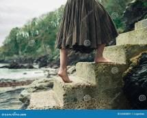 Woman Walking Barefoot Outside
