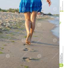 Barefoot Woman Walking Wet Sand Royalty Free Stock
