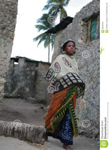 Barefooted Black African Moslem Young Woman In Headscarf