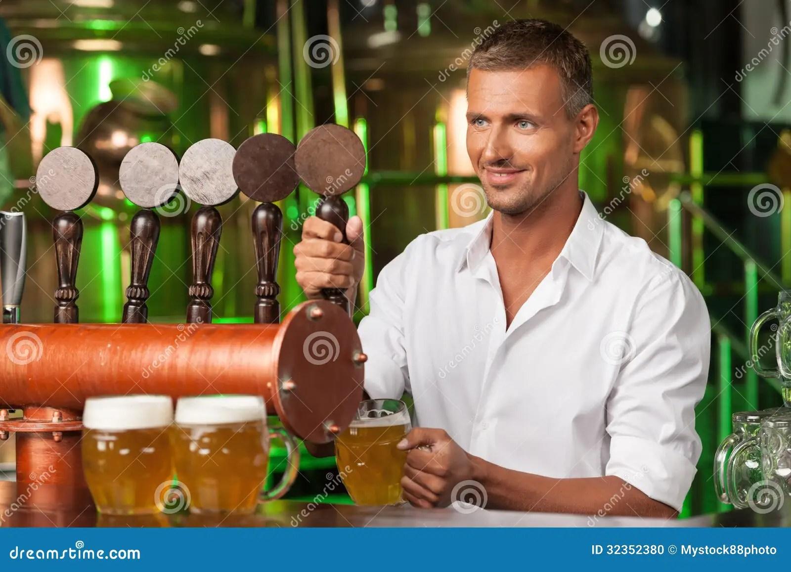 Bartender Serving Beer Handsome Bartender In White Shirt Servin Stock Photo  Image 32352380