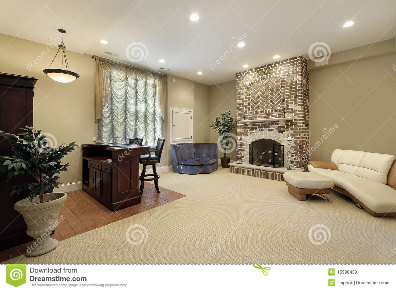 leather chair ottoman grey louis basement with brick fireplace stock image - image: 15990439