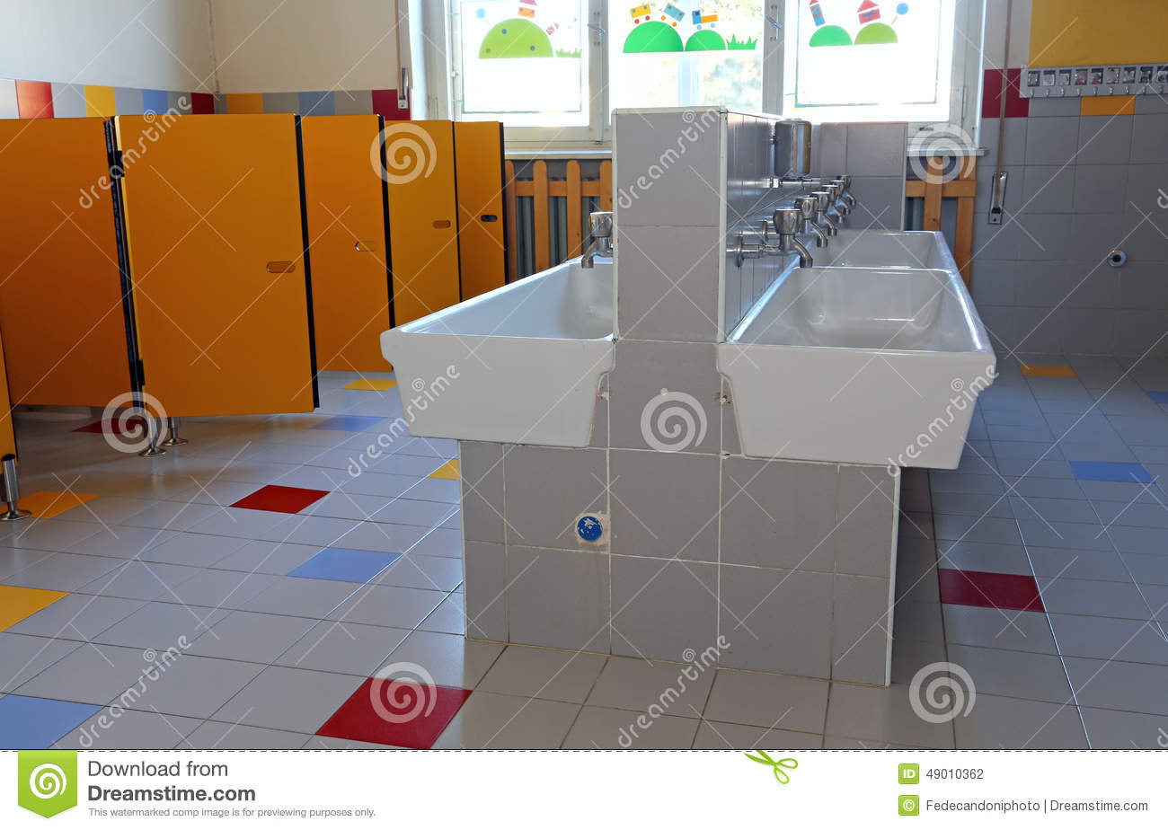Bathroom Of The Nursery School With Ceramic Sinks Stock
