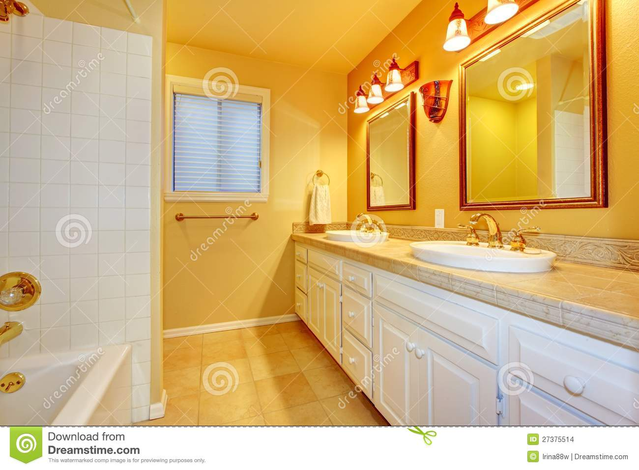 Bathroom With White Cabinets And Gold Walls Stock Photo