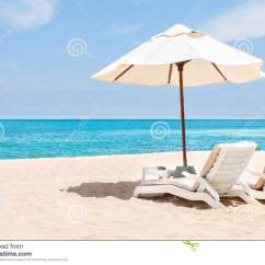 Beach Chairs With Umbrellas Who Sells Papasan And On The Sand Near Water Side Stock Photo