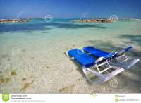 Beach chairs in the water stock photo. Image of green ...