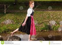 Beautiful Barefoot Woman In Dirndl Stock