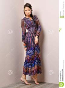 Beautiful Barefoot Woman in a Dress