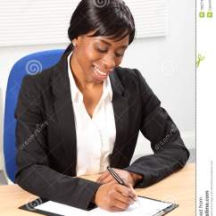 High Desk Chair Seat Covers Grand Rapids Mi Beautiful Black Business Woman Signing Document Stock Photography - Image: 19021482