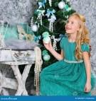 Beautiful Blonde Girl And Christmas Tree Stock