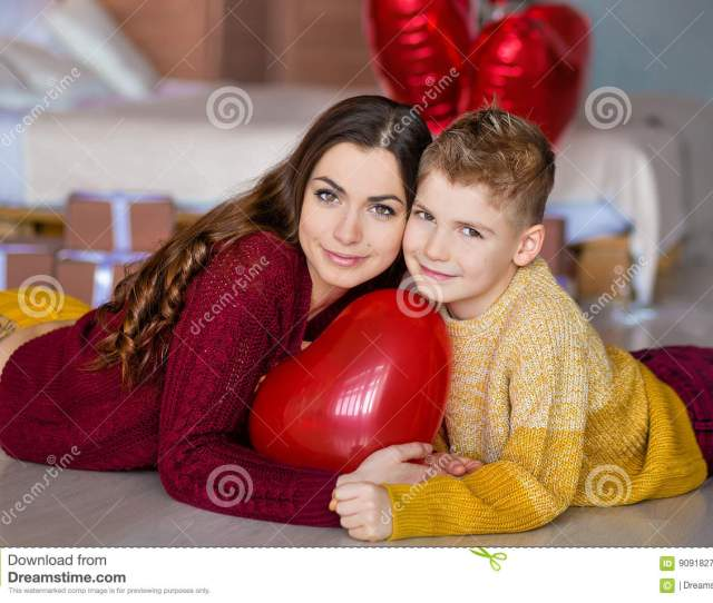 Beautiful Cute Young Brunette Mom Mother With Her Teenager Handsome Boy Holding Each Other And Happy