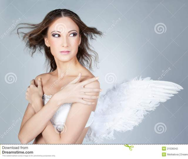 Beautiful Elegant Angel Girl On Gray Background