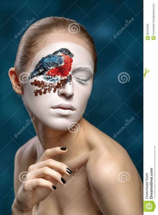 Beautiful Fashion Model With Face Art In Winter Style Stock - 36154943