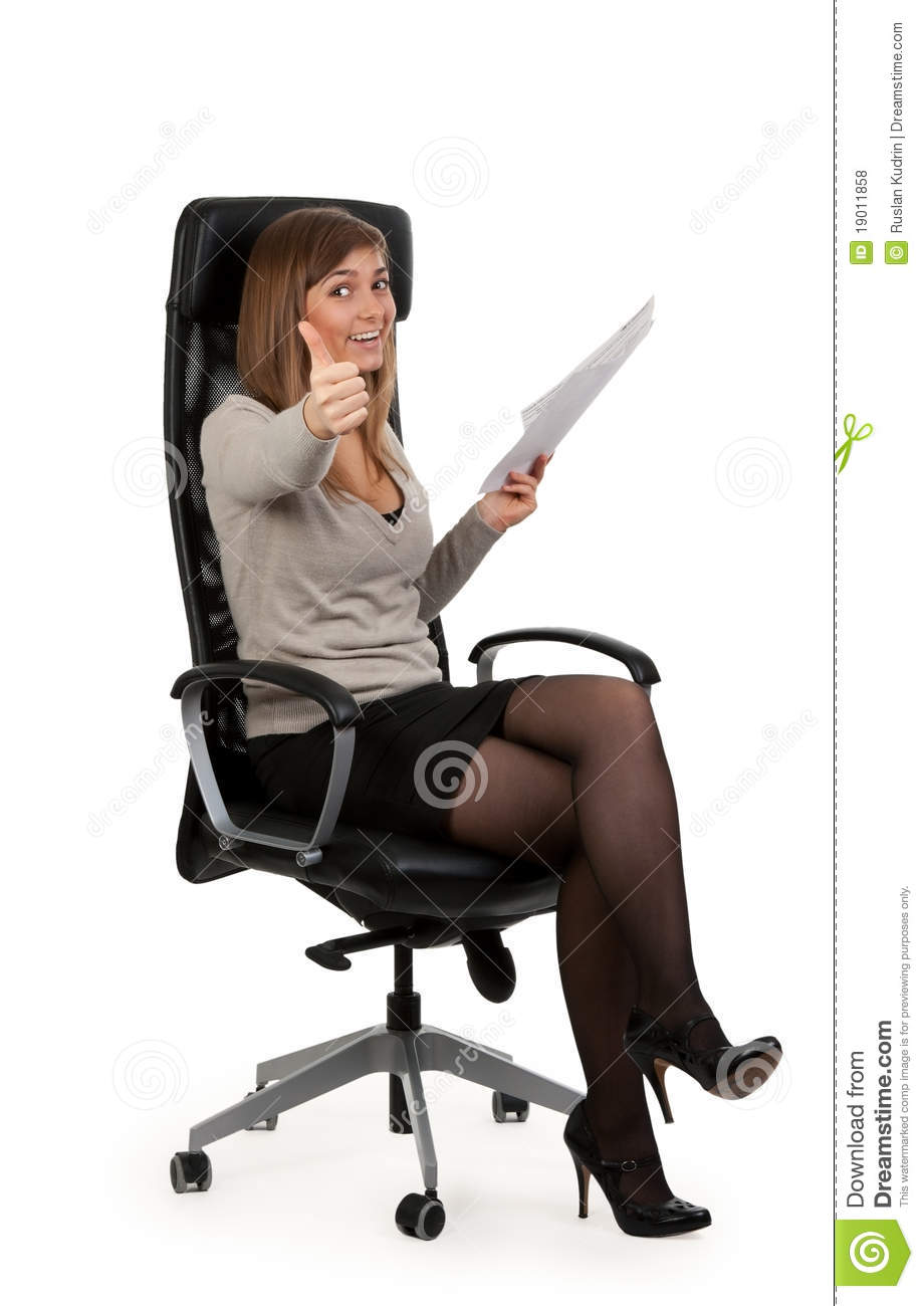Beautiful Girl Is Sitting In An Office Chair Royalty Free