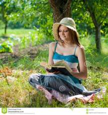 Beautiful Happy Smiling Women Reading Outdoors Stock
