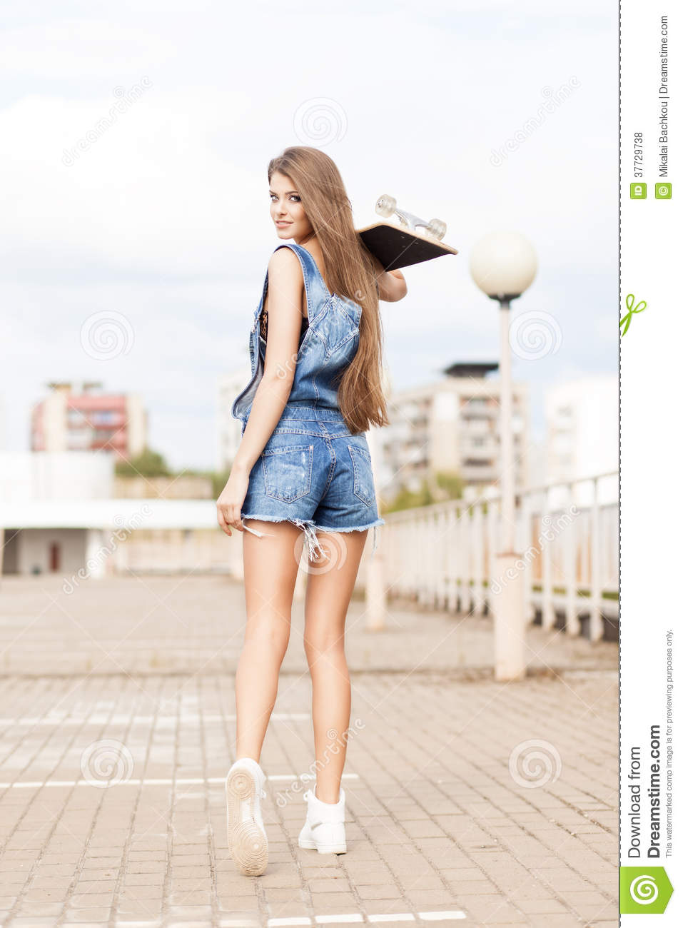 Beautiful Lady With Long Silky Hair In Denim Short