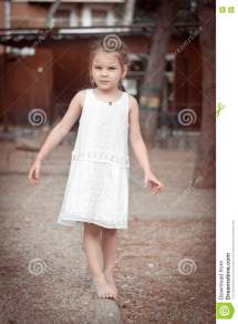 Dress Little Girl Walking Barefoot