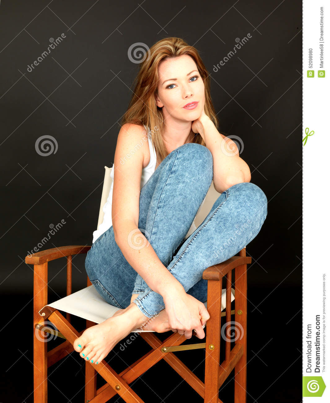 Beautiful Relaxed Young Woman Sitting In A Chair Stock