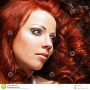 beautiful woman with red hair stock