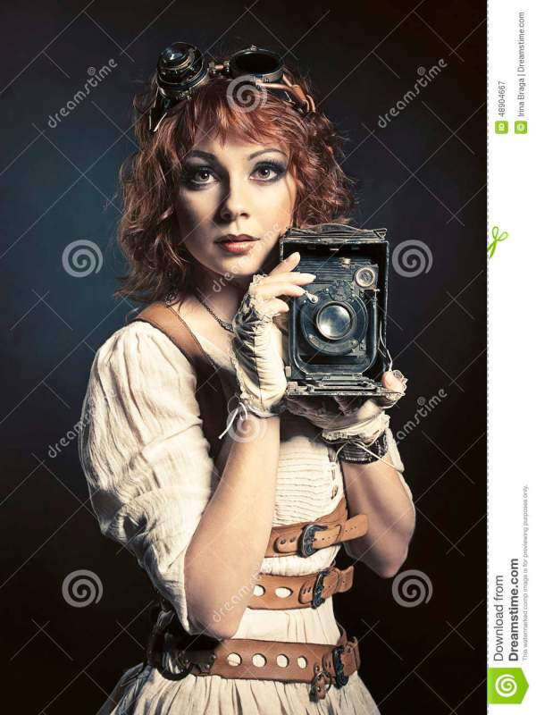 Beautiful Steampunk Girl With Camera Stock