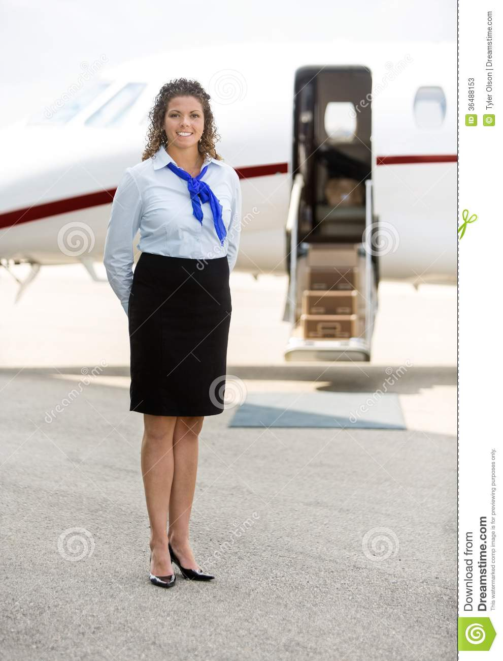 Beautiful Stewardess Standing Against Private Jet Stock Photos  Image 36488153