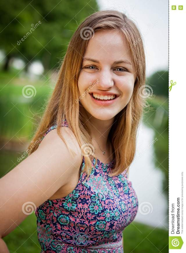 Beautiful High School Senior Girl Portrait Outside At A Park