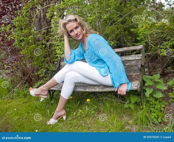 Beautiful Woman Bench Stock - 33275341