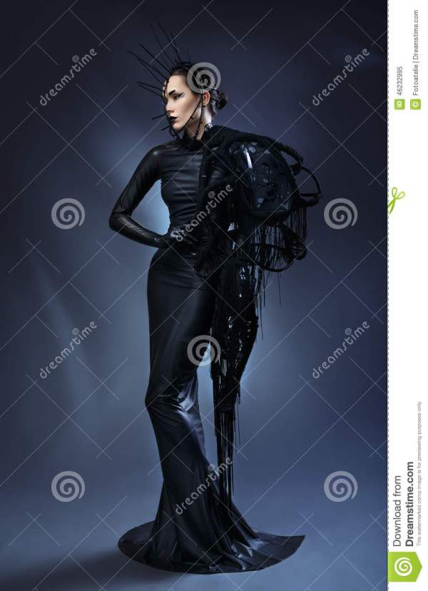 Beautiful Woman In Black Gothic Dress. Face Wearing Mask. Stock - Of Mask