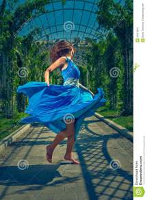 Beautiful Woman Dancing Barefoot In Long Blue Dress