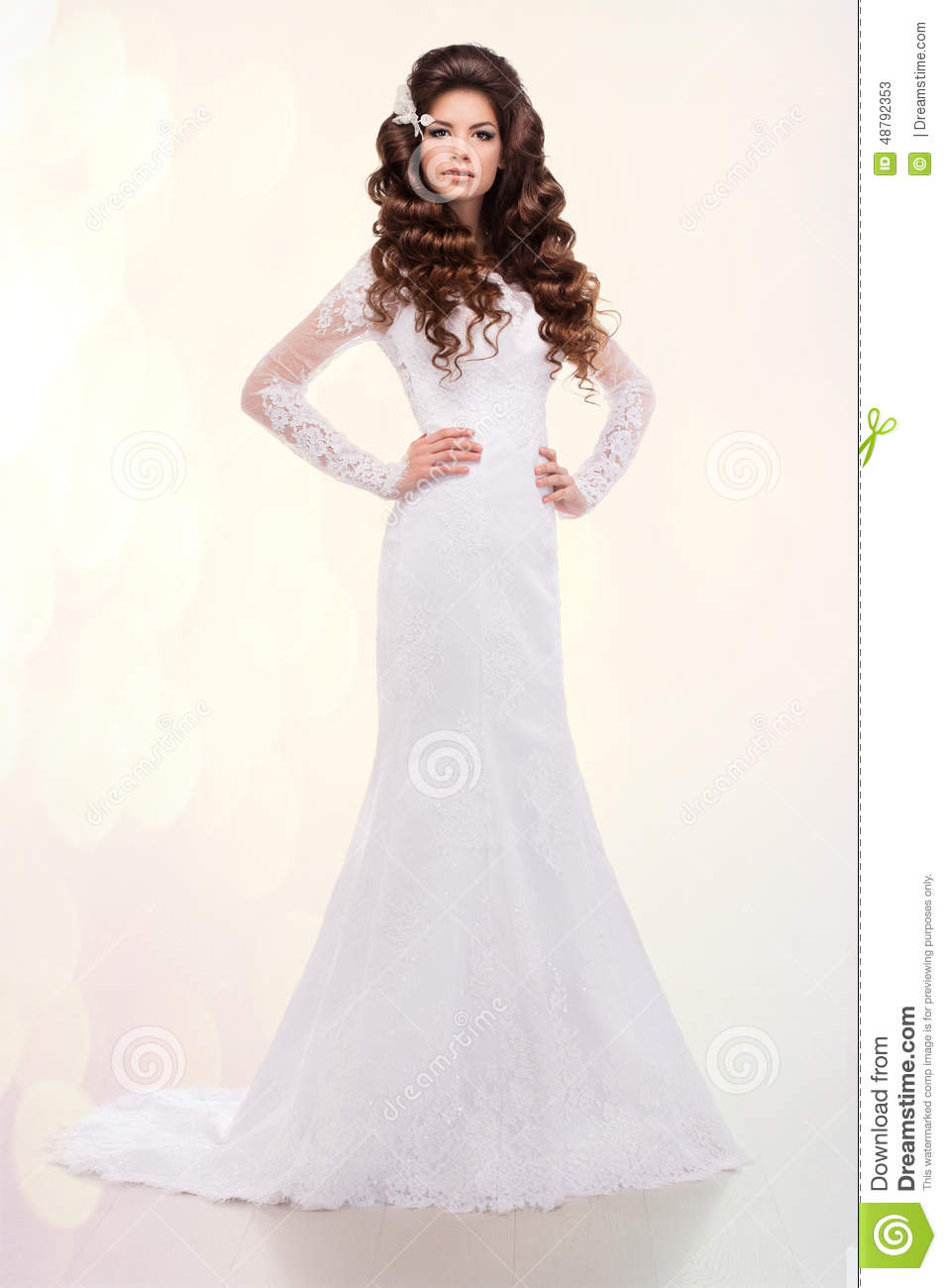 Beautiful Woman With Long Hair In Wedding Dress Over White