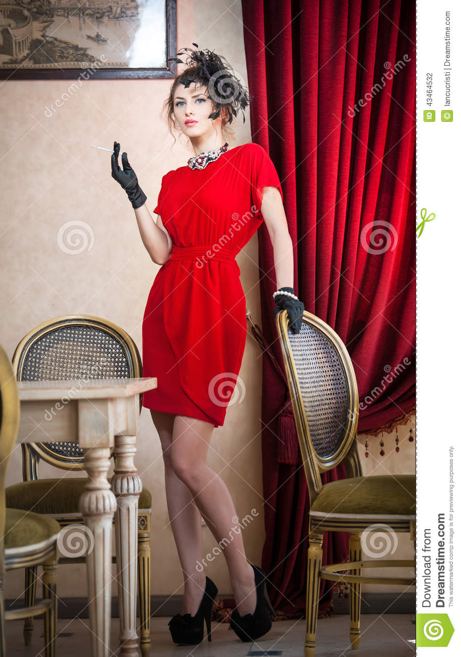 Beautiful Woman In Red With Gloves And Creative Hairstyle