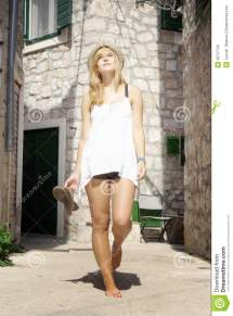 Beautiful Woman Walking Barefoot In Street Stock