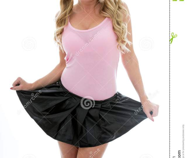 Attractive Young Woman Lifing Up Her Mini Skirt Looking Happy And