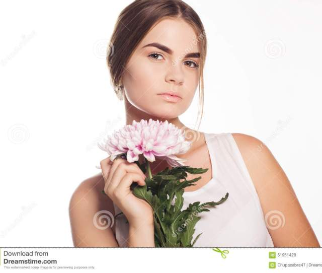 Beautiful Young Girl With Pink Flower