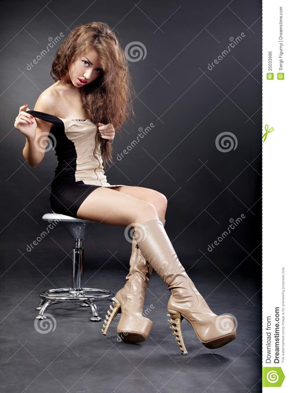 Beautiful Young Woman Wearing Boots On Black Stock Photo