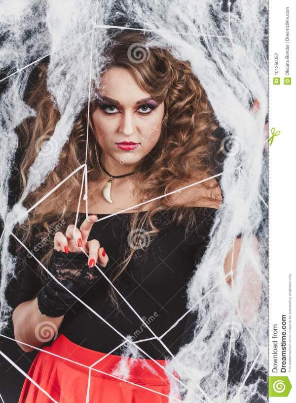 Beauty Witch Girl Caught In Spider Web. Fashion Art