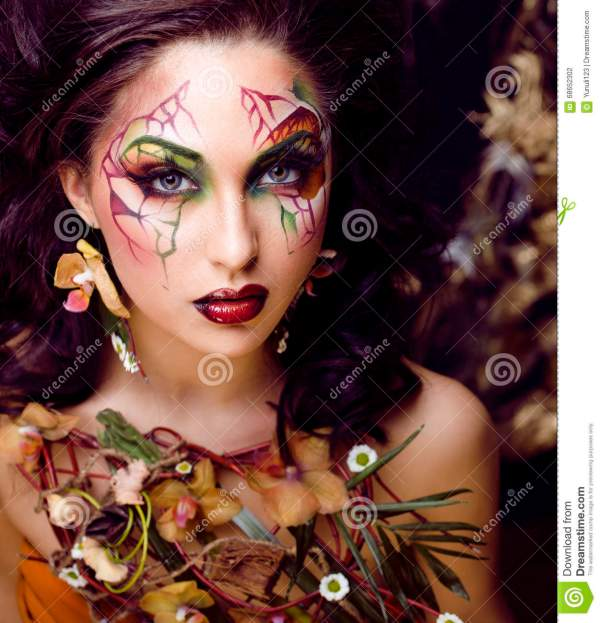 Beauty Woman With Face Art And Jewelry Flowers Orchids Close Creative Makeup Floral