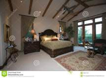 Bedroom With Beamed Ceiling And Patio Doors Royalty Free