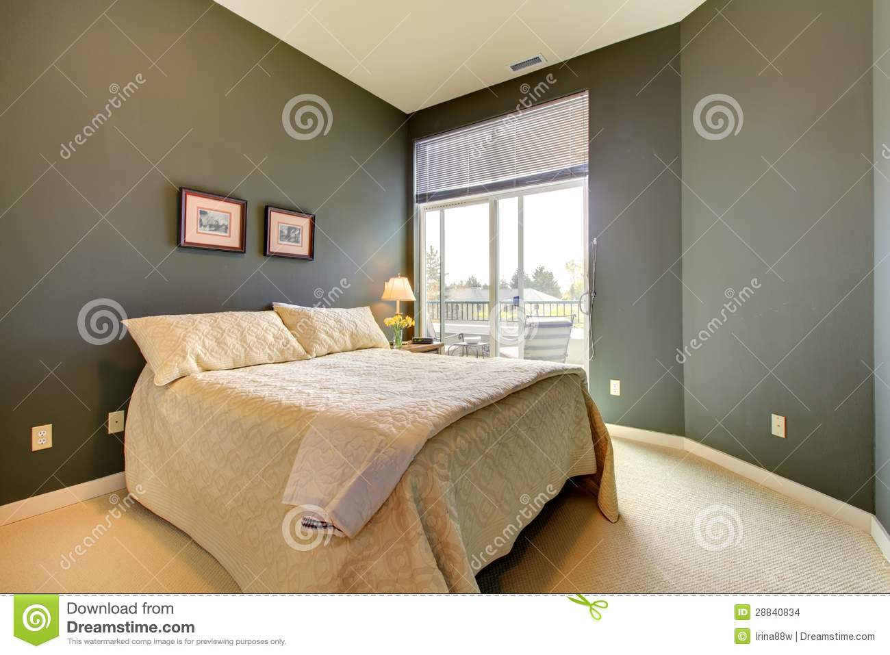 Bedroom Wiht Grey Green Walls And White Bedding Stock