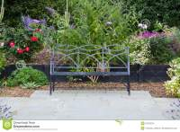 Bench Seat On Garden Patio With Flowers Stock Photo ...