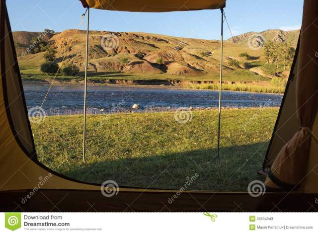 View looking out of door of tent upon great outdoors.
