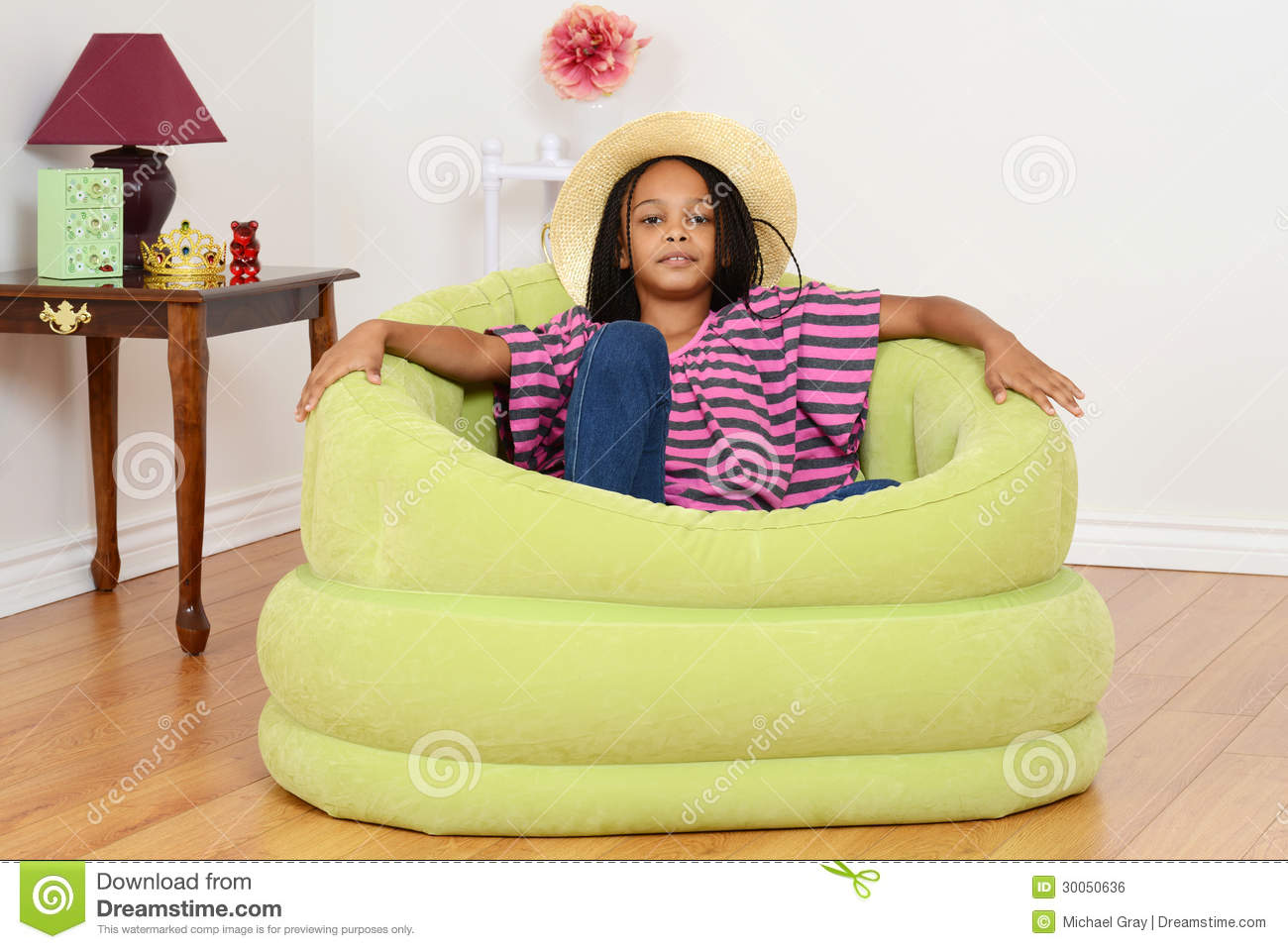 children s living room chairs michigan chair company black child relaxing in green stock photo image