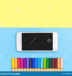 blank mobile phone and color marker pen line up on blue and yellow [ 1600 x 1448 Pixel ]