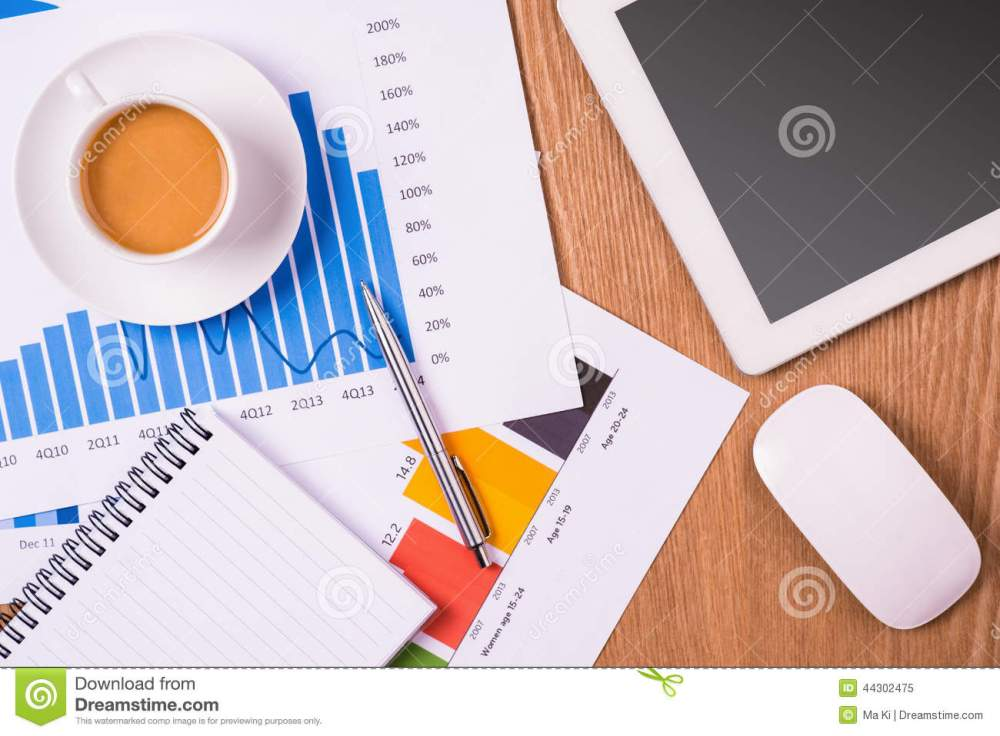 medium resolution of download blank notepad coffee cup over charts and tablet on wooden table stock image
