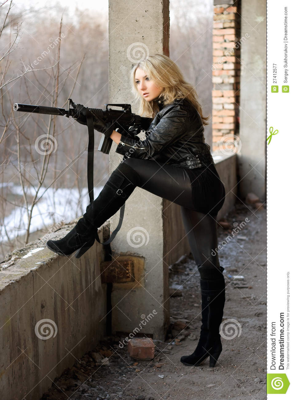 Blond Girl With Submachine Gun Royalty Free Stock