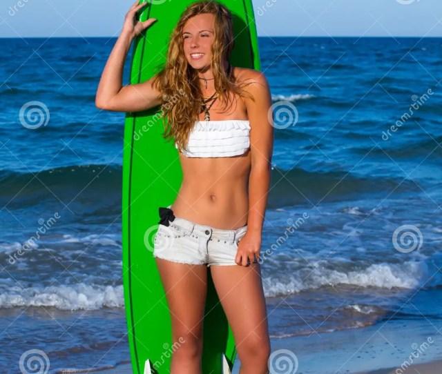 Stock Photo Blond Surfer Teen Girl Holding Surfboard On Beach