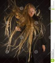 blond woman with wind blowing